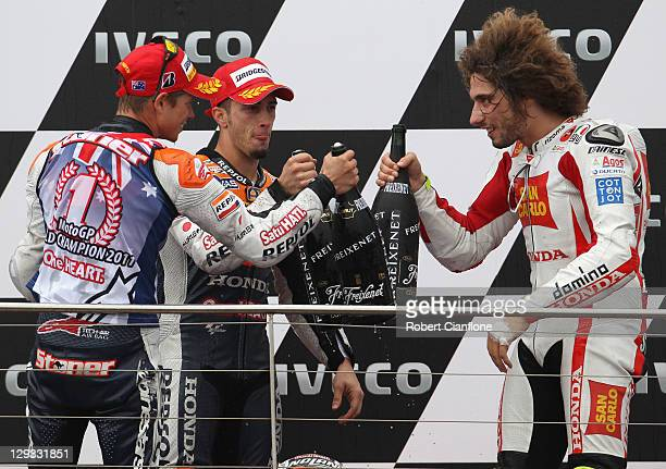 Casey Stoner of Australia and rider of the Repsol Honda Team Honda celebrates with Andrea Divizioso of Italy and Marco Simoncelli of Italy afterhe...