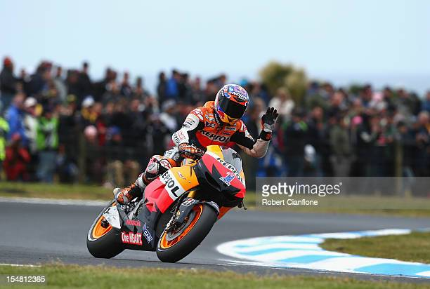 Casey Stoner of Australia and rider of the Repsol Honda Team Honda waves to the crowd after practice for the Australian MotoGP which is round 17 of...