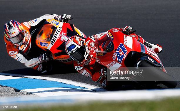 Casey Stoner of Australia and the Ducati Team leads Nicky Hayden of the USA and the Repsol Honda Team during the Australian MotoGP at the 2007...