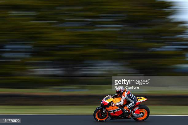 Casey Stoner of Australia rides the Repsol Honda Team Honda during practice for the Australian MotoGP which is round 17 of the MotoGP World...