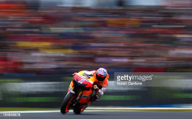 Casey Stoner of Australia rides the Repsol Honda Team Honda during the warm up session for the Australian MotoGP which is round 17 of the MotoGP...