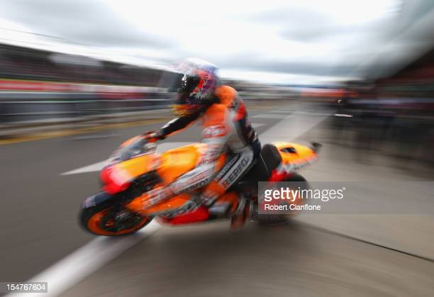 Casey Stoner of Australia rides the Repsol Honda Team Honda out of pit lane during practice for the Australian MotoGP which is round 17 of the MotoGP...