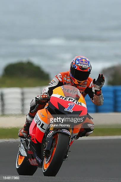 Casey Stoner of Australia rides the Repsol Honda Team Honda waves to the crowd after qualifying for the Australian MotoGP which is round 17 of the...