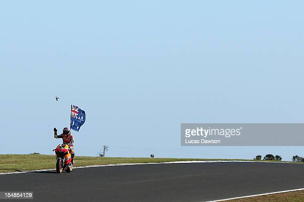 Casey Stoner of Australia riding the Repsol Honda Team Honda celebrates after winning the Australian MotoGP which is round 17 of the MotoGP World...
