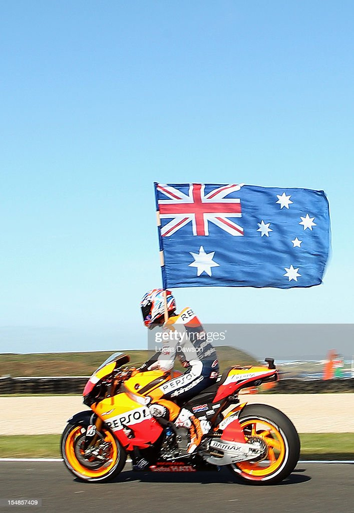 Casey Stoner of Australia riding the #1 Repsol Honda Team Honda celebrates after winning the Australian MotoGP, which is round 17 of the MotoGP World Championship at Phillip Island Grand Prix Circuit on October 28, 2012 in Phillip Island, Australia.