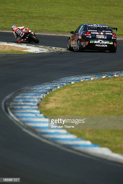 Casey Stoner of Red Bull Pirtek Holden and Jamie Whincup of Red Bull Racing Australia Holden drive during the Top Gear Festival at Sydney Motorsport...