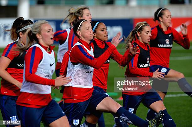 Casey Stoney and Alex Scott of England take part in the warm up during the England Women Training Session at St Georges Park on April 5 2016 in...