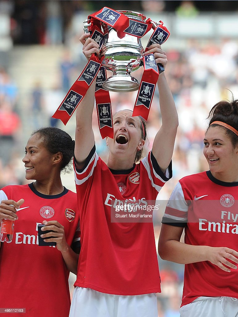 Casey Stoney lifts the FA Cup after the Arsenal victory at Stadium mk on June 1, 2014 in Milton Keynes, England.