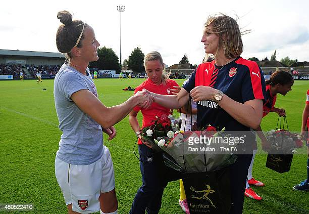 Casey Stoney of Arsenal receives a bouquet of flowers to celebrate her bronze medal on England duty at the Women's World Cup from Faye White former...
