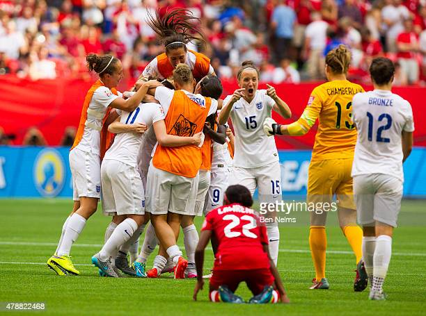 Casey Stoney of England celebrates with teammates after defeating Canada during the FIFA Women's World Cup Canada 2015 Quarter Final match between...