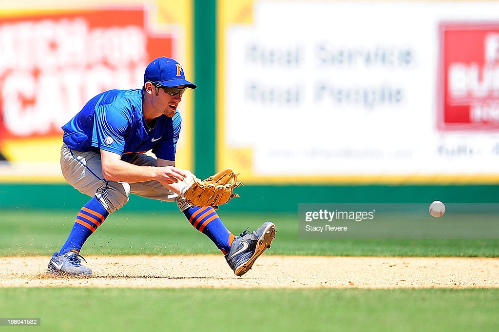 Casey Turgeon #2 of the Florida Gators fields a ground ball during a game against the LSU Tigers at Alex Box Stadium on May 4, 2013 in Baton Rouge, Louisiana.
