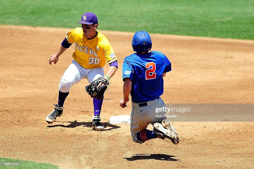 Casey Turgeon #2 of the Florida Gators slides into second base in front of a tag by Alex Bregman #30 of the LSU Tigers during a game at ALex Box Stadium on May 4, 2013 in Baton Rouge, Louisiana.