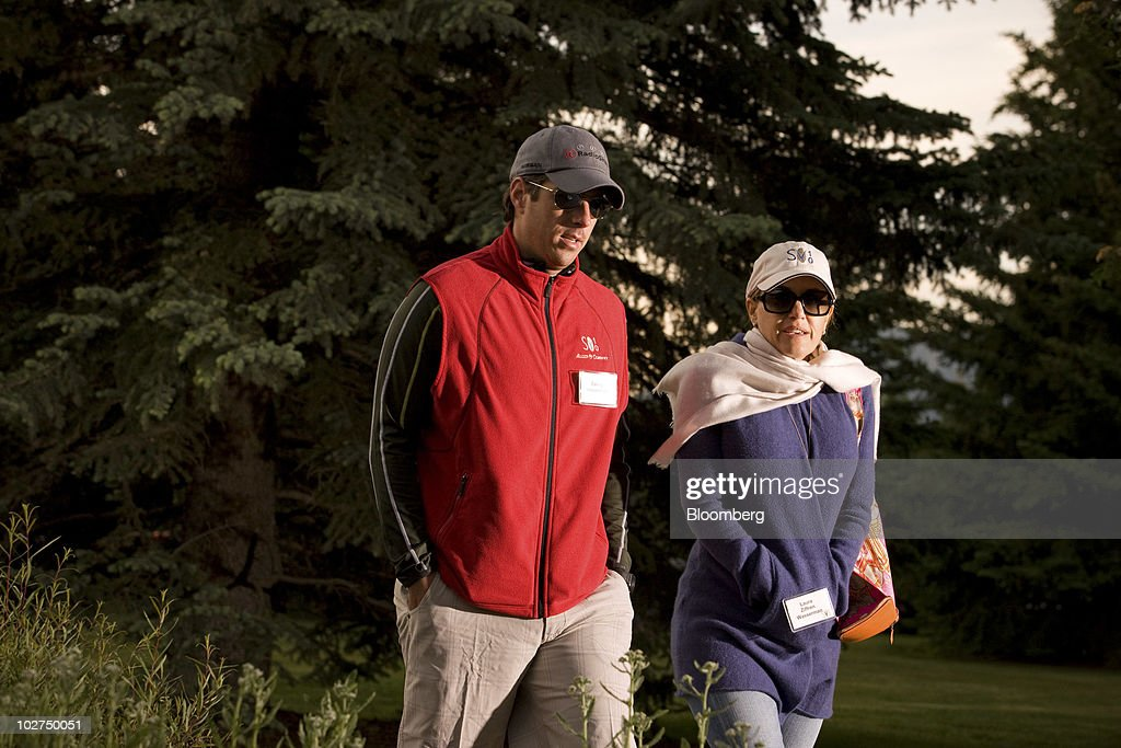 Casey Wasserman, chief executive officer of Wasserman Media Group, left, and his wife Laura Ziffren Wasserman arrive for morning sessions at the 28th annual Allen & Co. Media and Technology Conference in Sun Valley, Idaho, U.S., on Friday, July 9, 2010. Allen & Co., the boutique New York investment bank, invites executives from start-ups in media and technology to mingle with bankers and moguls at the event. The mixture, along with presentations trumpeting new business models, has led to acquisitions and investments in the past. Photographer: Matthew Staver/Bloomberg via Getty Images