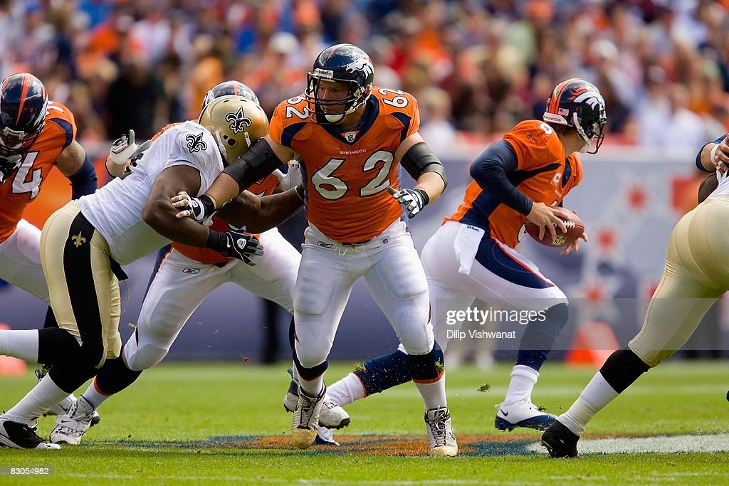 Casey Wiegmann #62 of the Denver Broncos blocks against the New Orleans Saints at Invesco Field at Mile High on September 21, 2008 in Denver, Colorado. The Broncos beat the Saints 34-32.