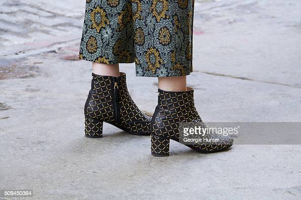 Casey Winston seen at The Apartment by The Line outside the Protagonist presentation wearing floral patterned Zara green and yellow pants and Chanel...