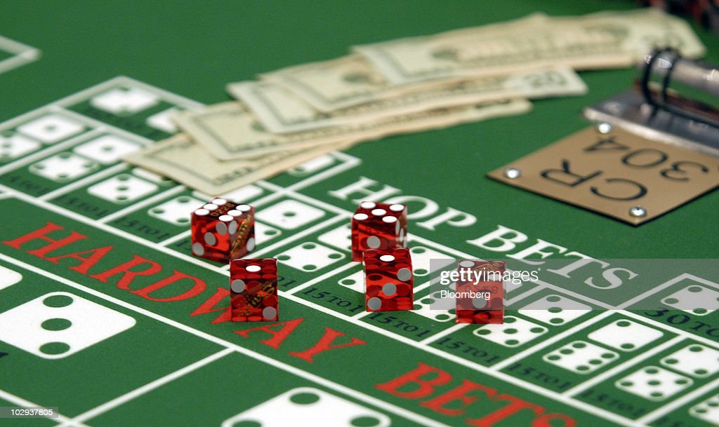 Cash And Dice Sit On A Craps Table At The Sands Casino Resort In Bethlehem,