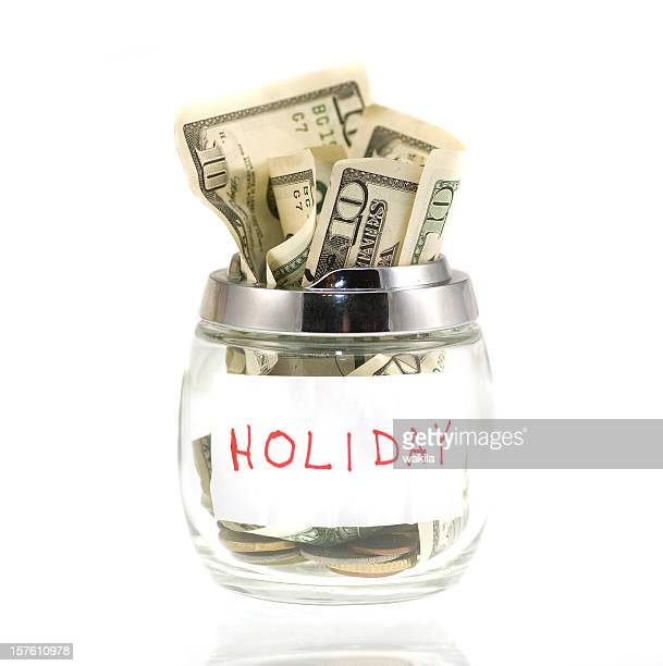 Cash for holiday in piggybank