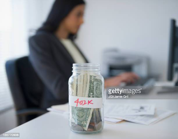 Cash in a jar marked 401k