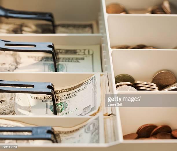 Cash register drawer full of money