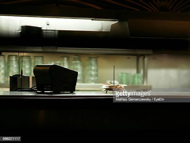 Cash Register On Kitchen Counter At Restaurant