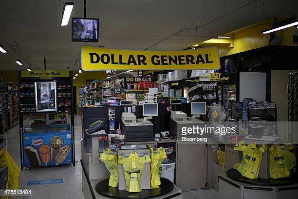 Cash registers are stand near the side entrance to a Dollar General Corp store in Scottsville Kentucky US on Tuesday May 26 2015 Dollar General Corp...