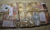 Cash seized by police following raid on a rave party at hotel Parth Inn on February 12 2015 in Ghaziabad India 72 people including six women arrested...