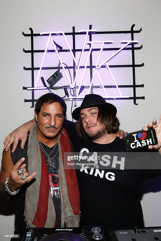 DJ Cash (R) spins at 'The Lifeguard' after party on January 19, 2013 in Park City, Utah.