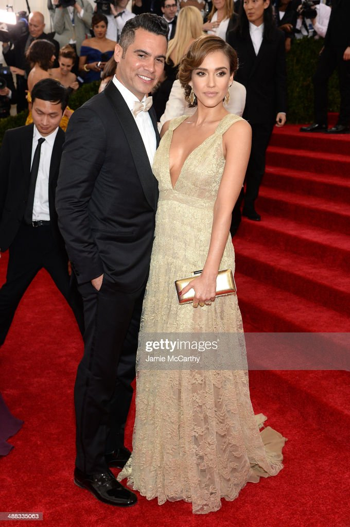 Cash Warren and Jessica Alba attend the 'Charles James Beyond Fashion' Costume Institute Gala at the Metropolitan Museum of Art on May 5 2014 in New...