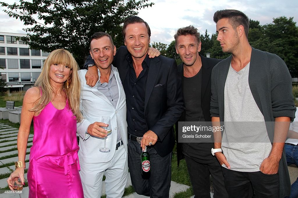 Casha Kellermann and husband Guido Kellermann, Norbert Dobeleit; Mark Keller and son Aaron attend the Norbert Dobeleit 50th birthday party at Stromberg Kutchiin on July 16, 2014 in Munich, Germany.