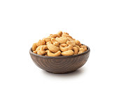 Cashews with wooden bowl , isolated on white