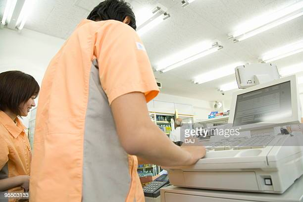 Cashier at cash register