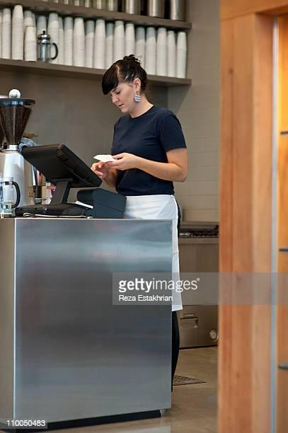 Cashier entering information at cash desk
