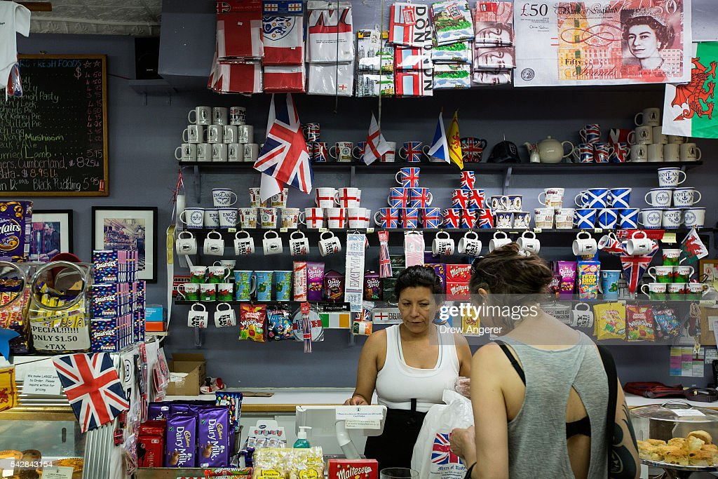A cashier helps a customer at Myers of Keswick, a British grocery store, June 24, 2016 in New York City. British citizens voted in a referendum (also known as the Brexit) to leave the European Union which has caused uncertainty across the world.