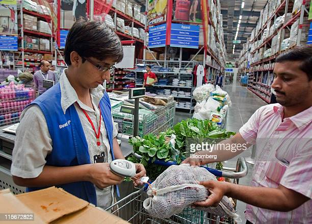 A cashier rings up a customer's groceries at a Bharti Walmart wholesale store in Zirakpur India on Sunday May 22 2011 WalMart Stores Inc blocked from...
