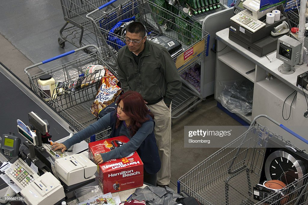 A cashier rings up a customer's merchandise inside a Sam's Club store in Mexico City, Mexico on Saturday, Nov. 17, 2012. El Buen Fin, Mexico's equivalent of Black Friday, when the year's biggest discounts are offered by participating stores, is held on the third weekend of November and will run through Nov. 19. Photographer: Susana Gonzalez/Bloomberg via Getty Images