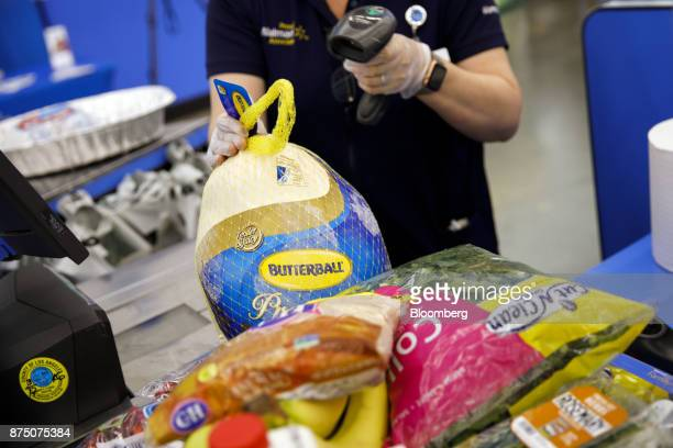 A cashier scans a Butterball turkey at a WalMart Stores Inc location in Burbank California US on Thursday Nov 16 2017 Black Friday the day after...