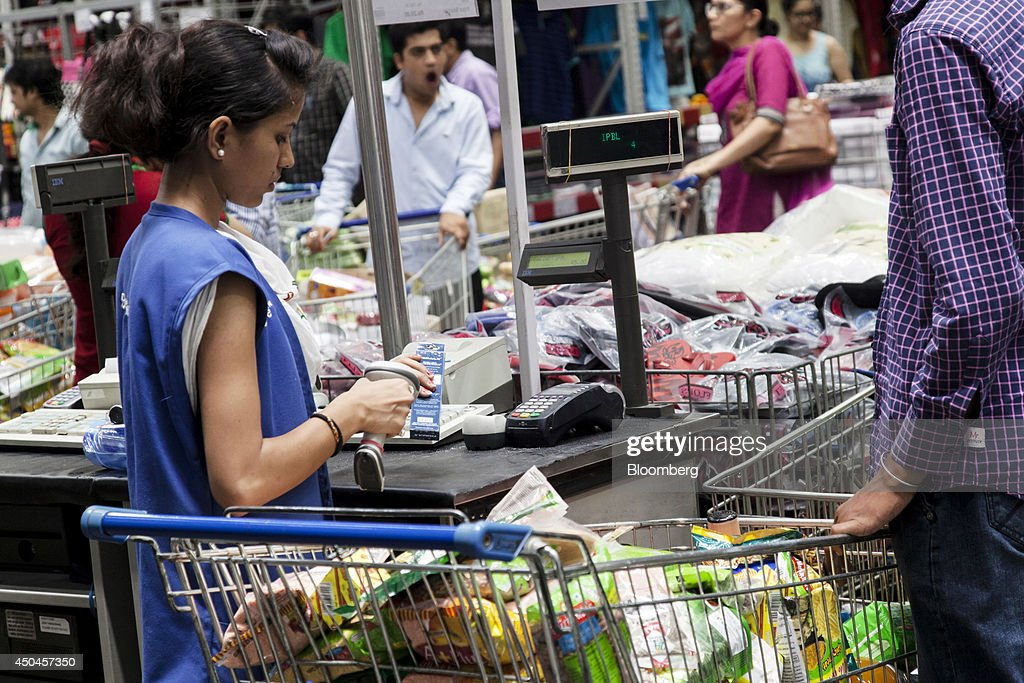 A cashier scans a purchase at a checkout counter inside a Walmart India Pvt. Best Price Modern Wholesale store in the town of Zirakpur on the outskirts of Chandigarh, Punjab, India, on Tuesday, June 10, 2014. India's consumer price index (CPI) figures and wholesale price inflation figures for May are scheduled for release on June 12 and 16 respectively. Photographer: Udit Kulshrestha/Bloomberg via Getty Images