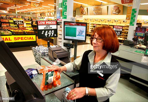 A cashier scans grocery items at a Woolworths Ltd supermarket in Sydney Australia on Thursday May 24 2007 Woolworths Ltd Australia's biggest retailer...