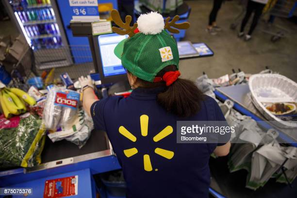 A cashier scans items for a customer at a WalMart Stores Inc location in Burbank California US on Thursday Nov 16 2017 Black Friday the day after...