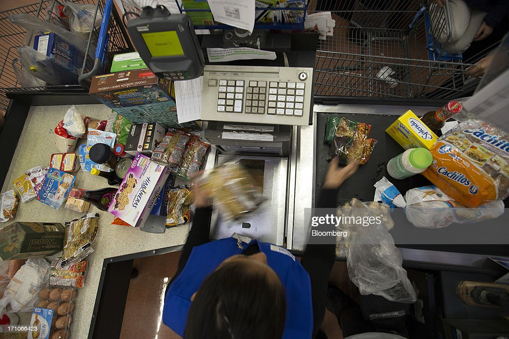 A cashier scans items for their prices at a Wal-Mart Stores Inc. location in Mexico City, Mexico, on Thursday, June 20, 2013. Mexican retail sales rose 2.5 percent in April from the same month last year, the country's statistics agency, known as Inegi, reported on its website. Photographer: Susana Gonzalez/Bloomberg via Getty Images