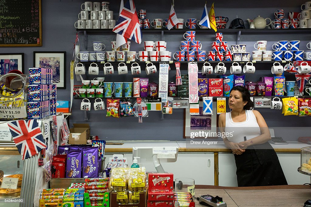 A cashier waits for customers at Myers of Keswick, a British grocery store, June 24, 2016 in New York City. British citizens voted in a referendum (also known as the Brexit) to leave the European Union which has caused uncertainty across the world.