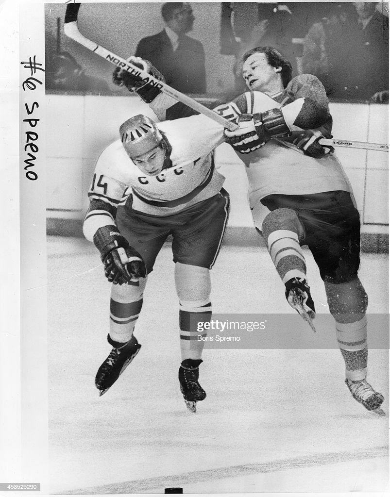 Rambunctious Wayne Cashman of the Boston Bruins more than meets his match when deciding to tangle with Russia's Yuri Shatalov. The Soviet player holds out a strong arm to send Cashman tumbling. In Canada vs. Soviet game at Vancouver, reader says fans were booing players like Wayne Cashman who prefer headhunting to hockey.