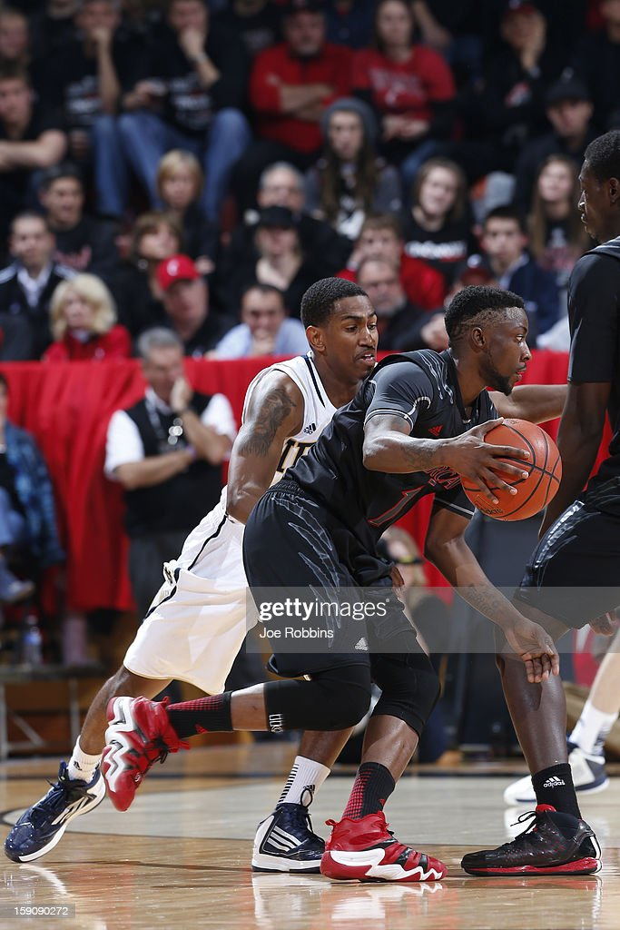 Cashmere Wright #1 of the Cincinnati Bearcats dribbles the ball around <a gi-track='captionPersonalityLinkClicked' href=/galleries/search?phrase=Eric+Atkins&family=editorial&specificpeople=7379862 ng-click='$event.stopPropagation()'>Eric Atkins</a> #0 of the Notre Dame Fighting Irish during the game at Fifth Third Arena on January 7, 2013 in Cincinnati, Ohio. Notre Dame won 66-60.