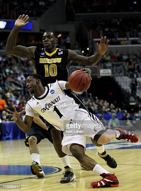 Cashmere Wright of the Cincinnati Bearcats drives against Ricardo Ratliffe of the Missouri Tigers during the second round of the 2011 NCAA men's...