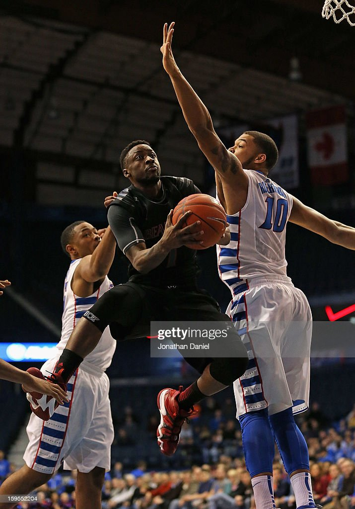 Cashmere Wright #1 of the Cincinnati Bearcats drives between Moses Morgan #15 (L) and Derrell Robertson Jr. #10 of the DePaul Blue Demons at Allstate Arena on January 15, 2013 in Rosemont, Illinois.