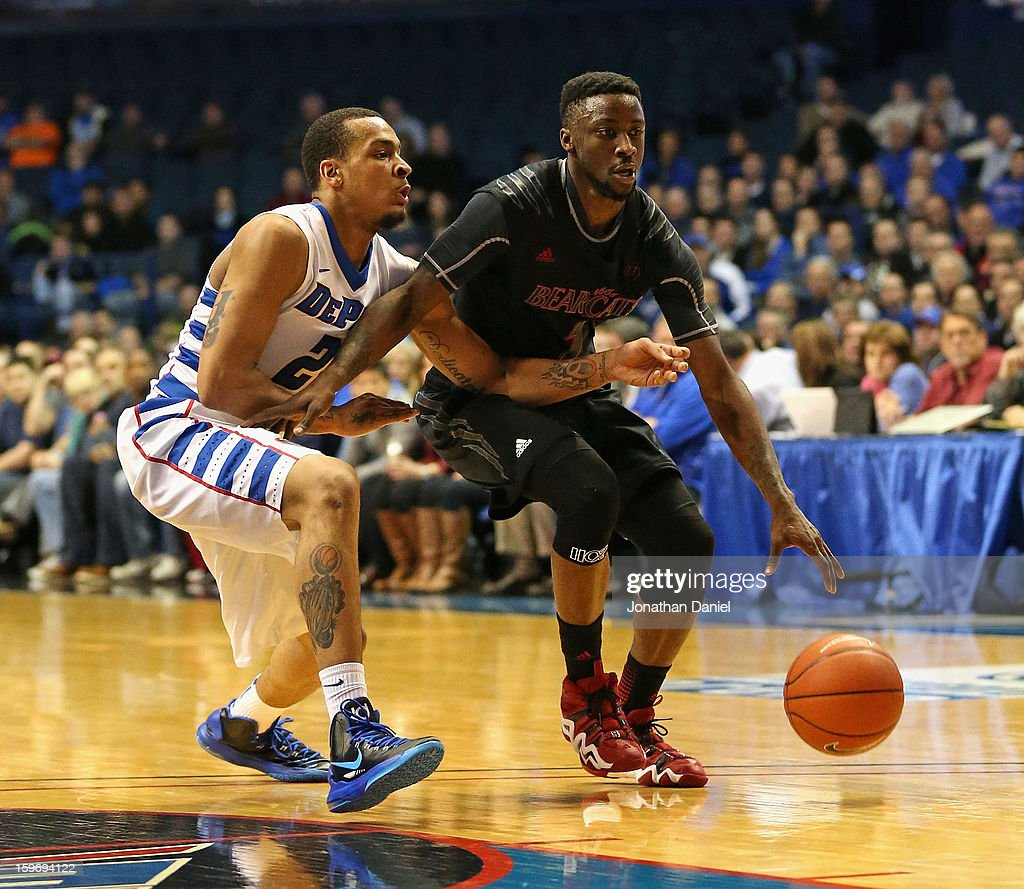 Cashmere Wright #1 of the Cincinnati Bearcats moves against Brandon Young #20 of the DePaul Blue Demons at Allstate Arena on January 15, 2013 in Rosemont, Illinois. Cincinnati defeated DePaul 75-70.