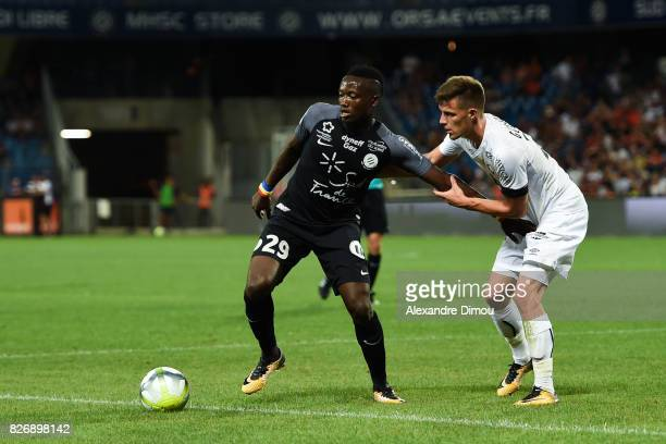 Casimir Ninga of Montpellier and Frederic Guilbert of Caen during the Ligue 1 match between Montpellier Herault SC and SM Caen at Stade de la Mosson...