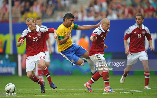 Casimiro of Brazil is challenged by Thomas Kahlenberg and Niki Zimling of Denmark during the International friendly match between Brazil and Denmark...