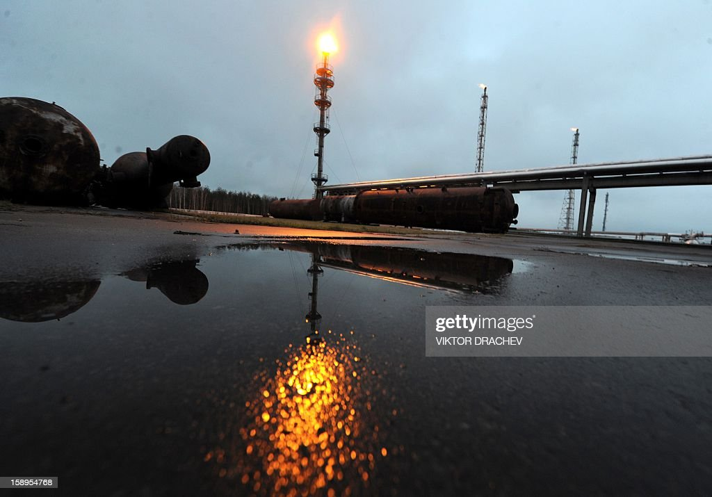Casing-head gas flares on a stack at the Mozyr oil refinery some 300 km south of Minsk in Mozyr on January 4, 2013. AFP PHOTO / VIKTOR DRACHEV