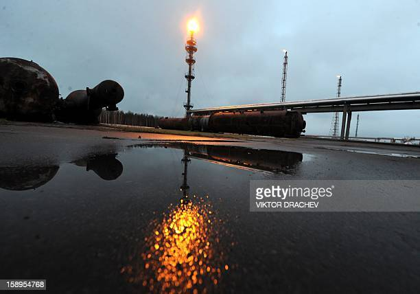 Casinghead gas flares on a stack at the Mozyr oil refinery some 300 km south of Minsk in Mozyr on January 4 2013 AFP PHOTO / VIKTOR DRACHEV